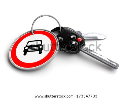 Car keys with road sign keyring. car symbol road sign traffic symbol - stock photo