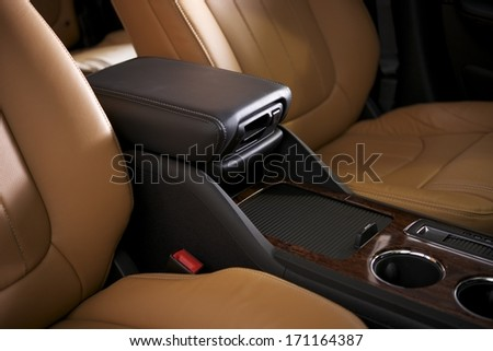 Car Leather Seats and Arm Rest. Modern Vehicle Interior Closeup. - stock photo
