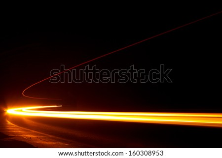 Car light trails. Art image . Long exposure photo taken in a tunne - stock photo
