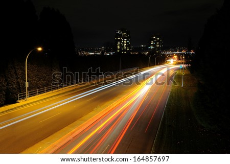 car light trails at night - stock photo