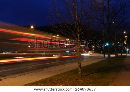 Car lights at night, long exposure photo of traffic - stock photo