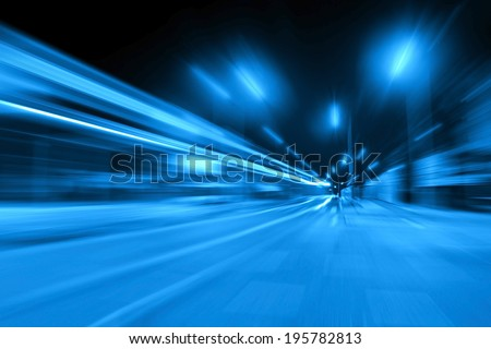 Car lights in the city at night - motion blur - stock photo