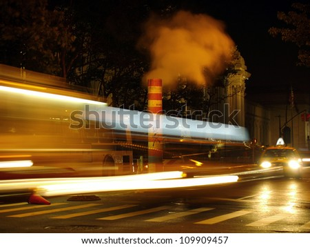 car lights on a highway, traffic cones fall over the road.  New York - stock photo