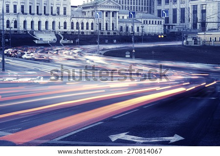 Car lights on the central city streets at sunset time - stock photo