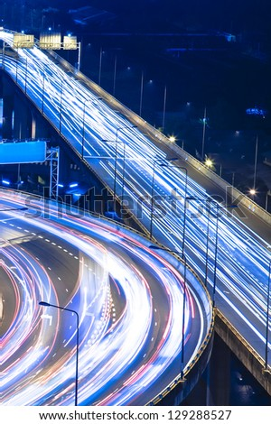 Car lights on the road at night - stock photo