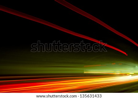 Car ligth trails. Art image . Long exposure photo taken in a tunnel - stock photo