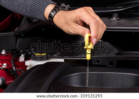 car maintenance, check the engine oil level - stock photo