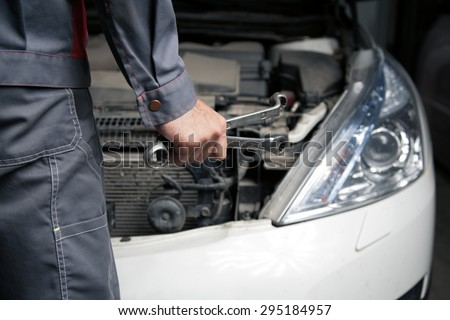 Car mechanic. Auto repair service. - stock photo
