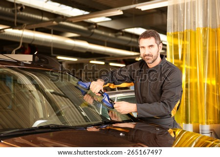 Car mechanic checking car at auto repair shop service station - stock photo