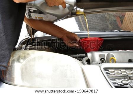 Car mechanic : engine oil change  - stock photo