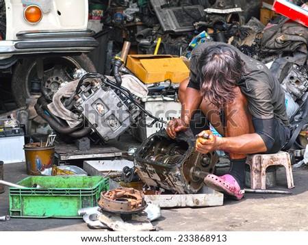 Car mechanic repair gear gearbox  - stock photo