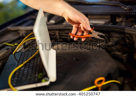 Car mechanic working in auto repair service, close up - stock photo