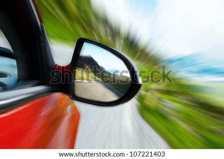 Car mirror, concept of speed - stock photo