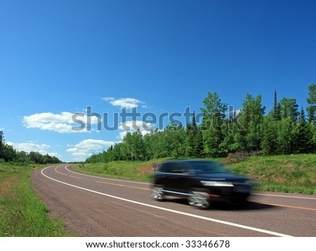 car moving on the road, lake Superior north shore - stock photo