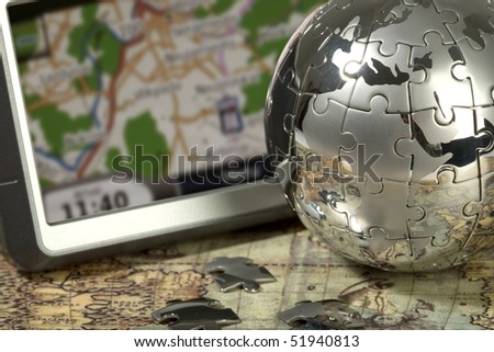 Car navigator on the old map. Concept travel. - stock photo