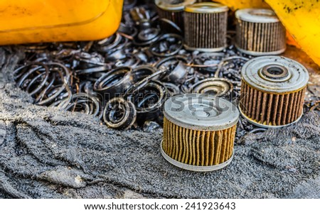 Car oil  Filters Located on the dirty area. - stock photo