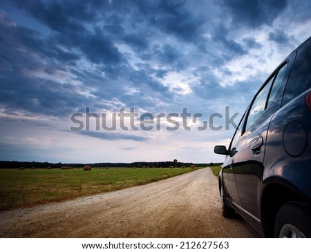 Car on country road - stock photo