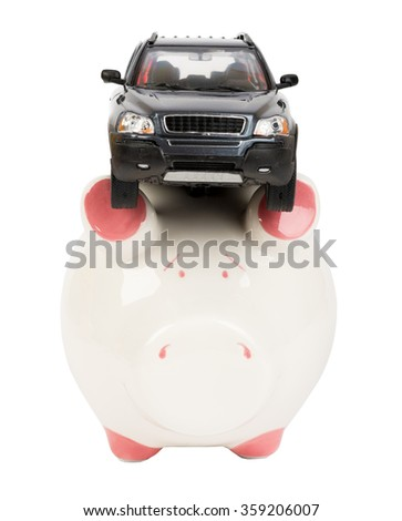 Car on piggy bank - stock photo