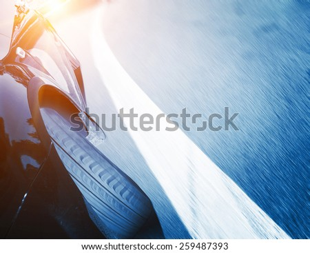 car on the road wiht motion blur background - stock photo