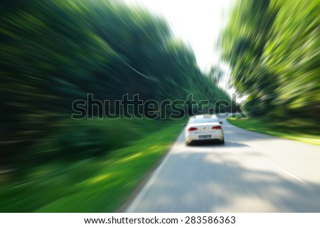 car on the road with motion blur background and zooming effect - stock photo