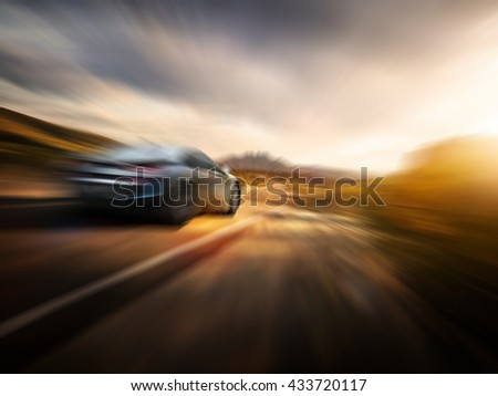 car on the road with the zoom motion blur background - stock photo