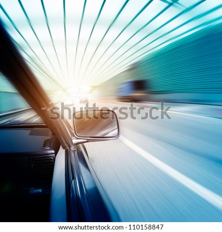 car on the tunnel wiht motion blur background - stock photo