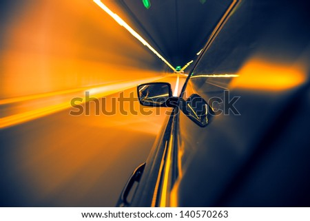 car on tunnel with light path - stock photo