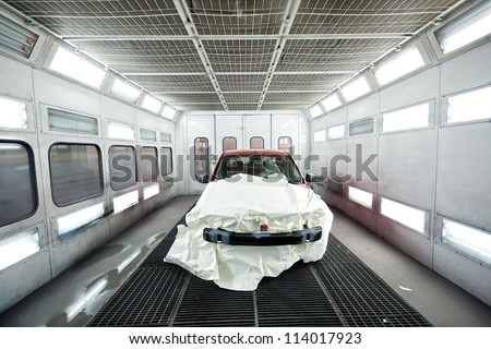 Car paint garage with car inside - stock photo