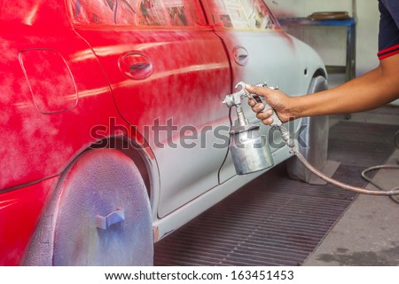 car painting at conventional garage - stock photo