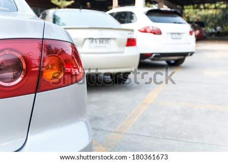 Car park in the line on daytime - stock photo