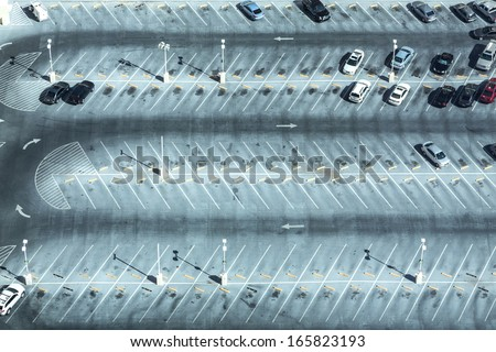 Car park seen from above with many empty parking lots - stock photo