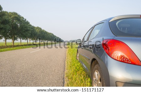 Car parked along a countryside road  - stock photo