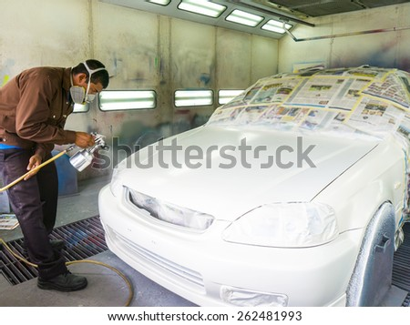 car repainting work at conventional garage - stock photo