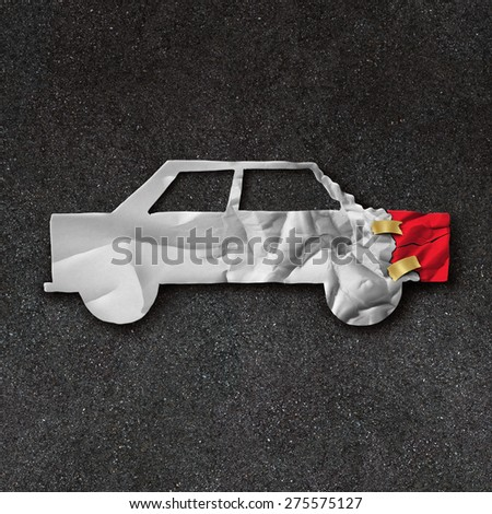 Car repair accident symbol and automobile crash fix concept on an asphalt road with  white crumpled paper shaped as a damaged and dented auto as an icon of insurance and mechanic repairing. - stock photo