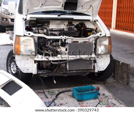 Car repair front, Dismantled parts out of the ground - stock photo