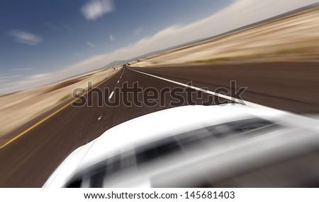 Car ride on road in Nevada desert- motion blur - stock photo