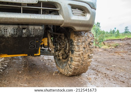 Car's wheels in mud - stock photo