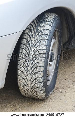 Car's wheels in mud - stock photo