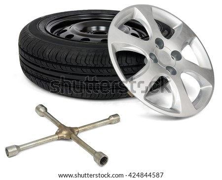 Car service. Car tyre with wheel cap and screwdriver. Isolated - stock photo
