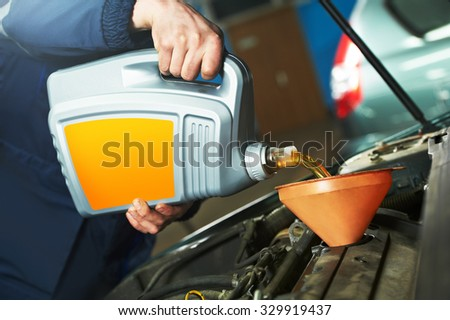 Car servicing, oil and filter replacing maintenance - stock photo