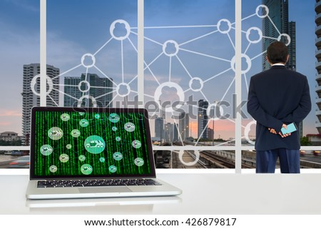 Car share concept. Sharing economy and collaborative consumption. Laptop computer with car sharing icons on digital code on screen against business man looking at the city  background. - stock photo