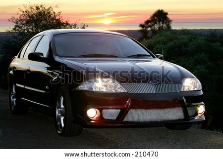 Car shot at sunset... - stock photo