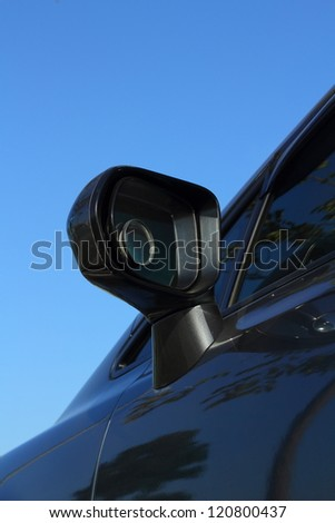 Car side mirror. - stock photo