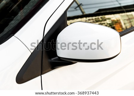 car side mirror, side rear-view mirror on a modern car - stock photo