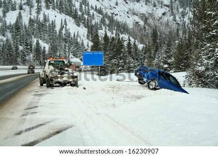 Car stuck in a snow bank on the side of the highway - stock photo