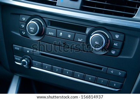 Car Temperature and Audio Controls - stock photo