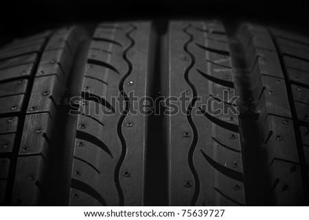 Car tire on black background - stock photo