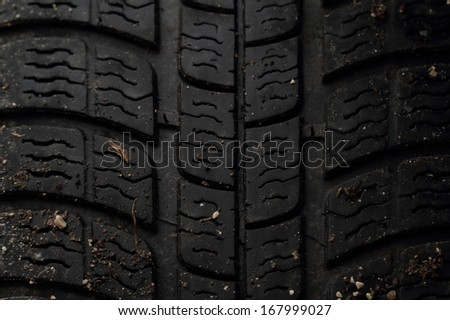 Car tire, photo on the black background - stock photo