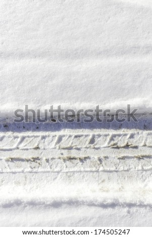 Car tire sign in fresh snow - stock photo