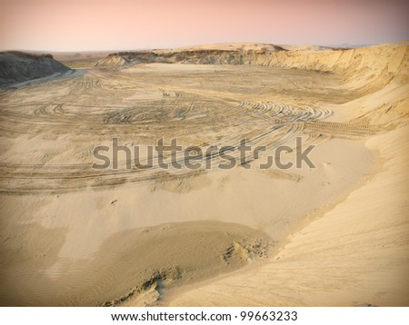 Car tire tracks in the desert - stock photo